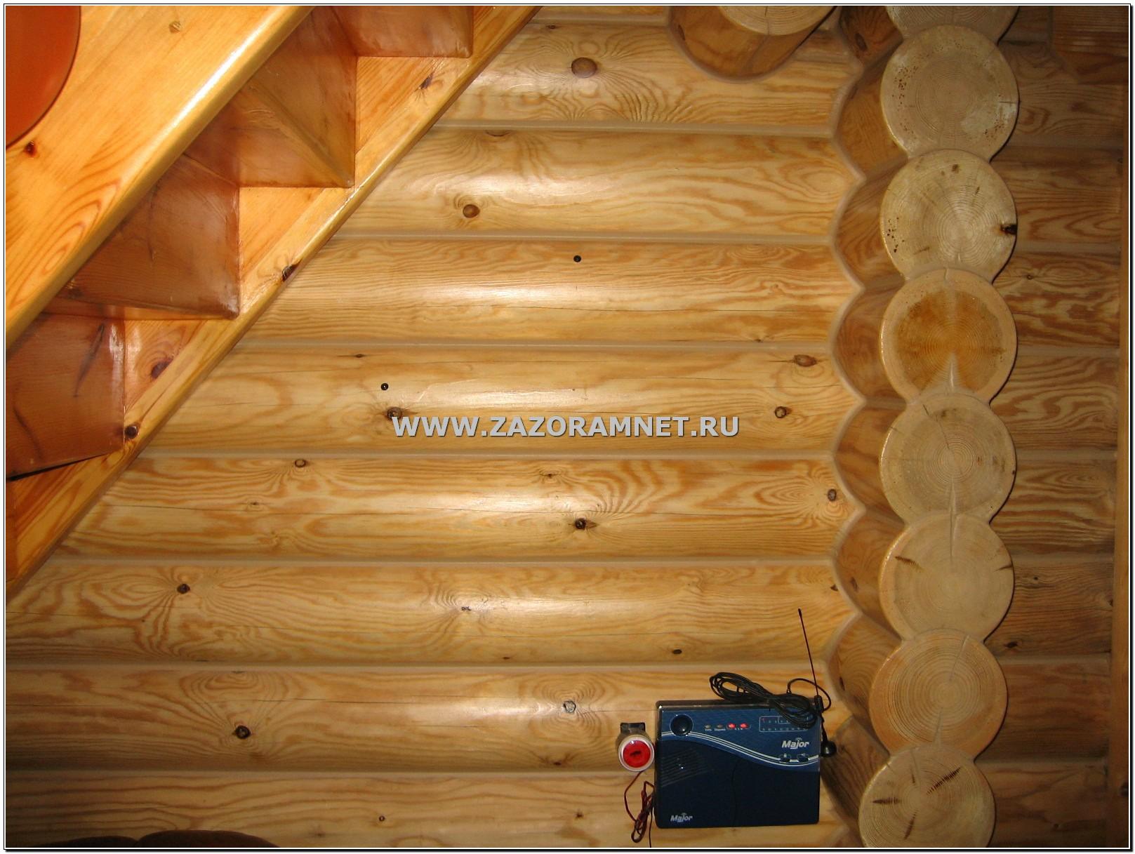 стена бревенчатого дома после утепления герметиком